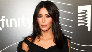 In this May 16, 2016 file photo, Kim Kardashian West attends the 20th Annual Webby Awards in New York. After an encounter with armed robbers in Paris on Monday, Oct. 3, Kardashian West went social media silent. On Instagram, where she has more than 84 million followers, the most recent posts were from the day before, having spent fashion week happily sharing snippets of video and photos, including one showing her massive diamond ring. (Photo by Andy Kropa/Invision/AP, File)