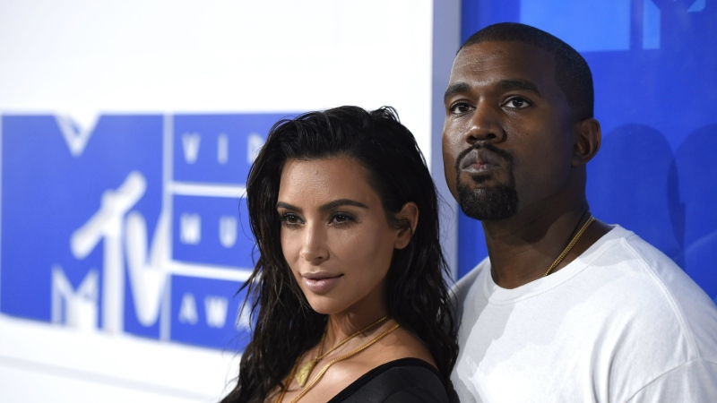In this Aug. 28, 2016 file photo, Kim Kardashian West, left, and Kanye West arrive at the MTV Video Music Awards in New York. (Photo by Evan Agostini/Invision/AP, File)