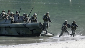 In this Thursday, Oct. 8, 2015, file photo, U.S. Marines from the 3rd Marine Expeditionary Brigade and the 31st Marine Expeditionary Unit and their Philippine counterpart take part in a boat raid exercise during their joint military exercise at the Philippine marines training center in Ternate township, Cavite province, south of Manila, Philippines. (AP / Bullit Marquez, File )