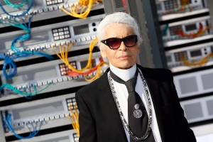 Fashion designer Karl Lagerfeld appears at the end of the presentation of Chanel's Spring-Summer 2017 ready-to-wear fashion collection presented in Paris, France on Tuesday, Oct.4, 2016. (AP / Francois Mori)