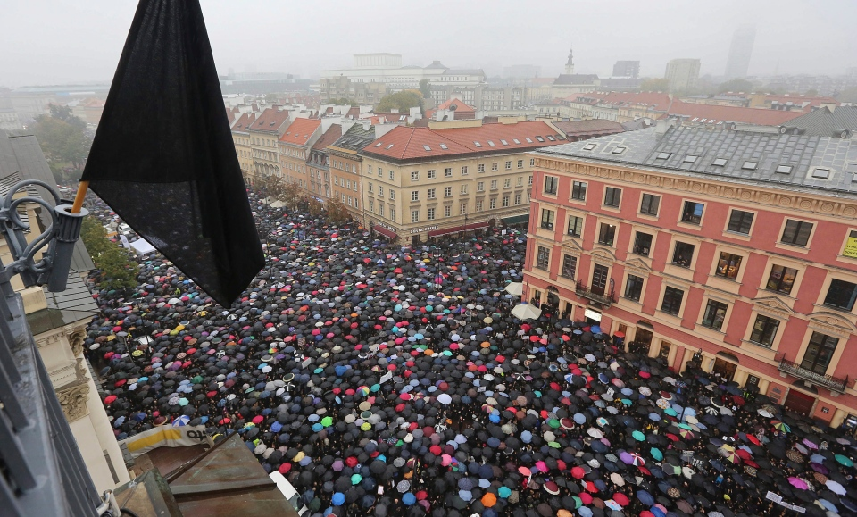 A sea of thousands of umbrellas of women and men participating in a nationwide, 'Black Monday' strike to protest a legislative proposal for a total ban on abortion, in downtown Castle Square is pictured in Warsaw, Poland, Monday, Oct. 3, 2016. (AP / Czarek Sokolowski)