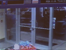 Security video at a Langley Chevron station shows two vehicles speeding around the lot while the occupants fired at each other. February 11, 2009.