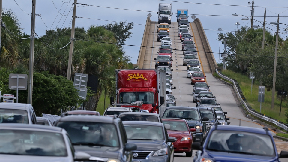 People in vehicles make an evacuation route over 520 bridge heading west from Merritt Island, Fla. as Hurricane Matthew approaches Florida on Wed., Oct. 5, 2016. (Red Huber / Orlando Sentinel)