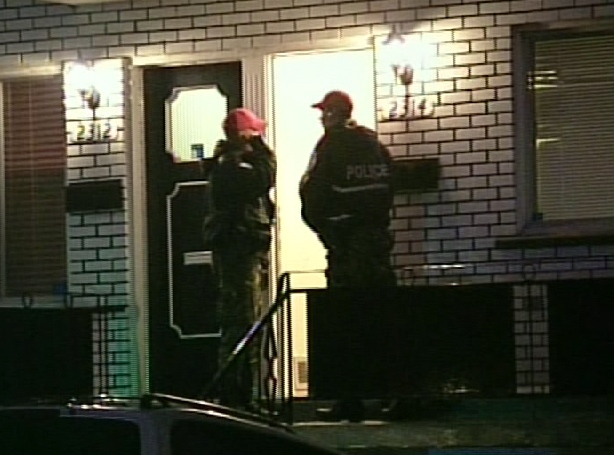 Police in Montreal search a house targeted in the raids early Thursday, Feb. 12, 2009.