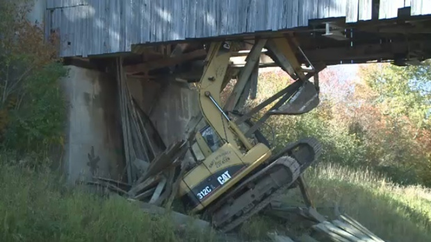 This excavator crashed through a 104-year-old covered bridge in French Village, N.B. on Oct. 5, 2016.