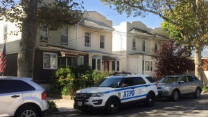 The house, left, where officers conducting a welfare check discovered the decomposing body of Erika Kraus-Breslin in Queens, New York, on Oct. 6, 2016. (Mike Balsamo)