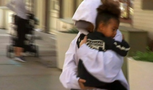 In this image made from video, Kim Kardashian West carries her daughter North West to an awaiting vehicle, Thursday, Oct. 6, 2016, in New York. (AP Photo/Zoran Drakulic)