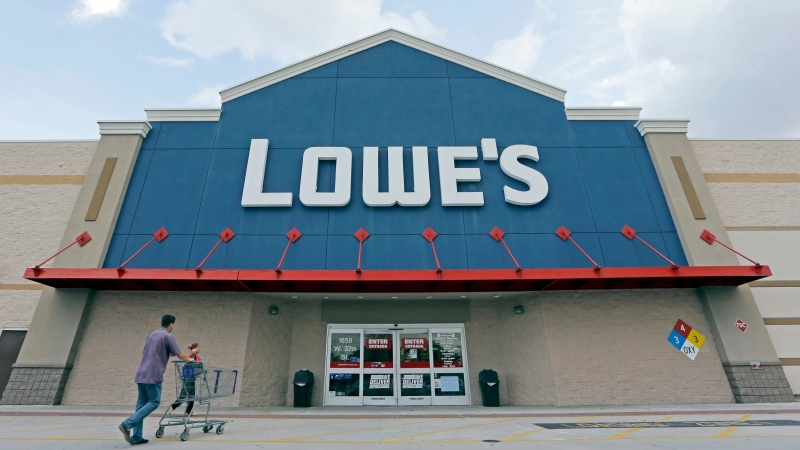 In this Wednesday, June 29, 2016, photo, customers walk toward a Lowe's store in Hialeah, Fla. Lowe's reports financial results Wednesday, Aug. 17. (AP Photo/Alan Diaz)