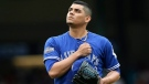 Toronto Blue Jays' Roberto Osuna taps his chest after getting Texas Rangers' Carlos Beltran to strike out, to end the bottom of the eighth inning of Game 2 of baseball's American League Division Series, Friday, Oct. 7, 2016, in Arlington, Texas. (AP Photo/LM Otero)