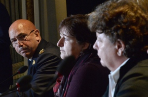 RCMP commissioner Bob Paulson, left, answers a question during a news conference, as plaintiffs Janet Merlo, centre, and Linda Davidson look on, in Ottawa Thursday, Oct. 6, 2016. (Adrian Wyld / THE CANADIAN PRESS)