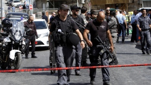 Israeli police secures the scene where a car driven by a Palestinian gunman was intercepted by the police and gunman shot dead in Jerusalem Sunday, Oct. 9, 2016. (Mahmoud Illean/AP Photo)