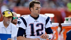 New England Patriots quarterback Tom Brady (12) watches from the bench late in the second half of an NFL football game against the Cleveland Browns, Sunday, Oct. 9, 2016, in Cleveland. (AP Photo/David Richard)