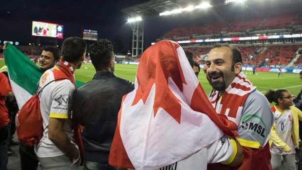 Syrian refugees at Toronto FC game