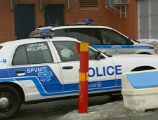 Police transport suspects rounded up during the early-morning raids in Montreal, Thursday, Feb. 12, 2009.