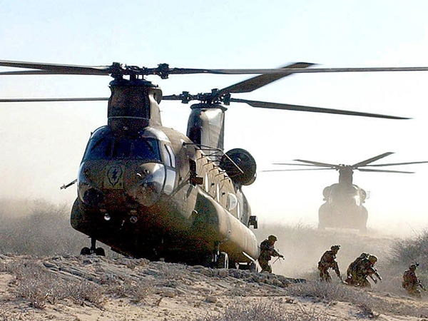 Soldiers exit a CH-47 Chinook helicopter during operations as seen in this image made available by the U.S. Army.
