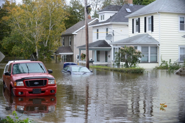 A vehicle is submerged in a residential area of Sydney, N.S., Tuesday, Oct.11, 2016. (THE CANADIAN PRESS/Vaughan Merchant)