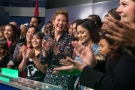 Sophie Gregoire Trudeau, centre, stands with girls representing G(girls)20 FitSpirit/Fillactive and Plan International Canada after opening the market at the TSX in Toronto to celebrate International Day of the Girl, on Tuesday October 11, 2016. (Chris Young / THE CANADIAN PRESS)