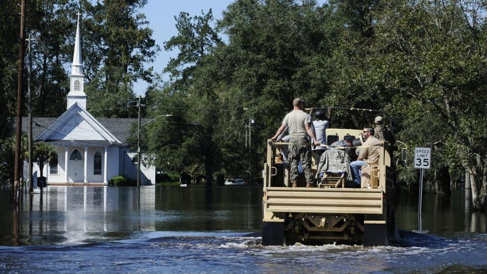 A National Guard high-water vehicle drives through Nichols, S.C. on Tuesday, Oct. 11, 2016. (AP / Rainier Ehrhardt)