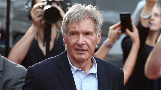In this December 10, 2015 file photo, Harrison Ford greets fans during a Star Wars fan event in Sydney. (Rob Griffith/AP)