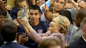 Democratic presidential candidate Hillary Clinton poses for photos after speaking at a rally at Miami Dade College in Miami, Tuesday, Oct. 11, 2016. (Mike Stocker / South Florida Sun-Sentinel via AP)