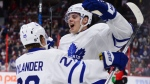 Toronto Maple Leafs center Auston Matthews celebrates a first period goal with teammate William Nylander during NHL hockey action in Ottawa on Wednesday, Oct. 12, 2016. THE CANADIAN PRESS/Sean Kilpatrick