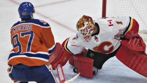 Calgary Flames' goalie Brian Elliott makes the save on Edmonton Oilers' Connor McDavid during third period NHL action in Edmonton, Alta., on Wednesday October 12, 2016. (Jason Franson / THE CANADIAN PRESS)