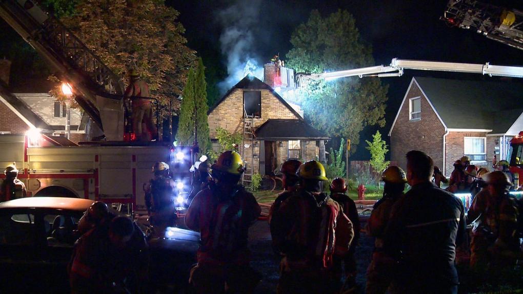 Firefighters work on a house fire in Verdun