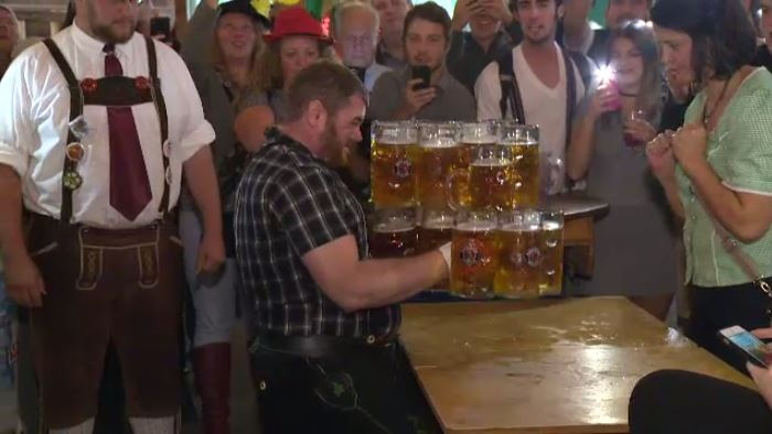 Steve Richtaritsch attempts to set a new world record by carrying 30 steins full of beer on Wednesday, October 12, 2016. (CTV Kitchener)