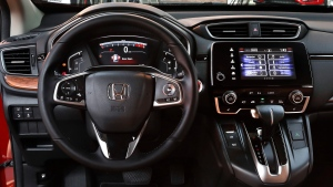 This Wednesday, Oct. 12, 2016, photo shows an interior view of the 2017 Honda CR-V, in Detroit. America's family car is no longer the Toyota Camry or some other midsize car. It's the Honda CR-V, a compact SUV, that's getting its first overhaul since 2012. (Paul Sancya/AP)