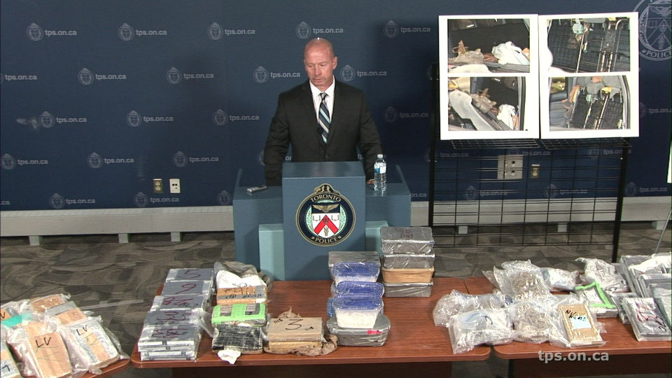 Inspector Steven Watts stands behind a large quantity of drugs that was seized as part of a recent investigation.