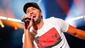 In this June 12, 2016 file photo, Luke Bryan performs at the CMA Music Festival in Nashville, Tenn. The country singer is in currently performing in his Farm Tour, where he brings concerts to working farms in small agriculturally-focused communities and cities throughout the South and Midwest. (Al Wagner/Invision/AP)