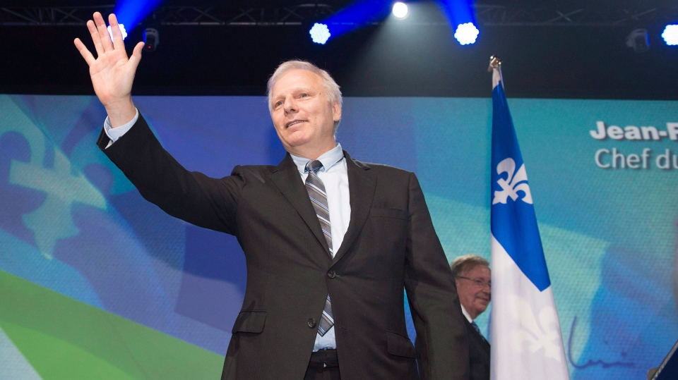 The new Parti Quebecois leader Jean-Francois Lisee waves to supporters after he was elected at the Parti Quebecois leadership event, Friday, October 7, 2016 in Levis Que. THE CANADIAN PRESS/Jacques Boissinot