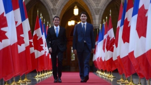 Canadian Prime Minister Justin Trudeau and French Prime Minister Manuel Valls walk to a joint media availability on Parliament Hill in Ottawa, Thursday October 13, 2016. THE CANADIAN PRESS/Sean Kilpatrick