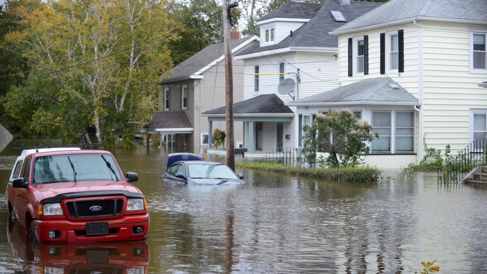 A vehicle is submerged in a residential area of Sydney, N.S., Tuesday, Oct.11, 2016. (Vaughan Merchant/THE CANADIAN PRESS)