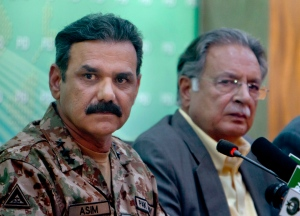 Pakistan's army spokesman Asim Saleem Bajwa, left, and Information Minister Pervaiz Rashid listen to a reporters during a press conference in Islamabad, Pakistan, Tuesday, March 29, 2016. (AP / Anjum Naveed)