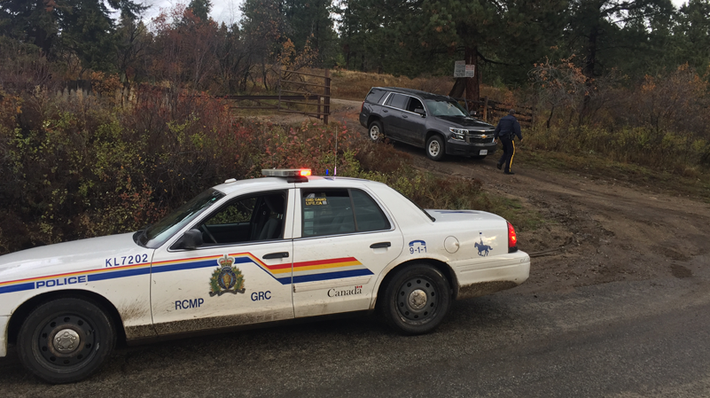 RCMP vehicles guards access to the site of a plane crash that killed four people near Kelowna, B.C. (Kent Molgat)
