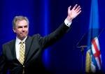 Jim Prentice, a former Alberta PC premier and former federal cabinet minister in the Conservative government of Stephen Harper, died in a plane crash in British Columbia.<br><br>   Outgoing Premier Jim Prentice waves after his speech at the Alberta PC Dinner in Calgary on Thurs. May 14, 2015. (THE CANADIAN PRESS/Larry MacDougal)
