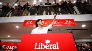 Prime Minister Justin Trudeau, centre, waves as he attends a campaign event for Liberal party byelection candidate Stan Sakamoto in Medicine Hat, Alta., Thursday, Oct. 13, 2016. (THE CANADIAN PRESS/Jeff McIntosh)