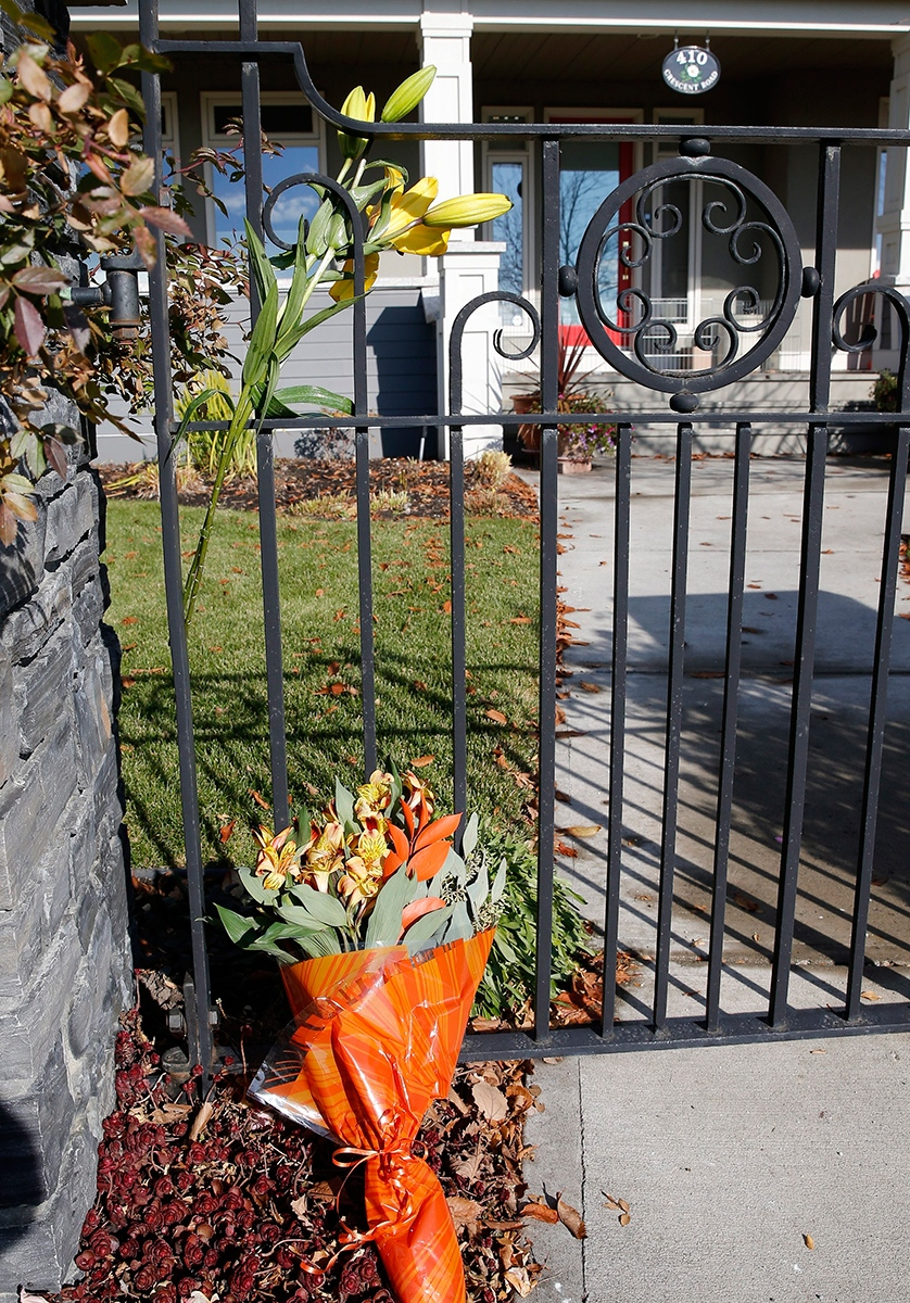 Flowers left at the entrance gate at the family home of former Alberta Premier Jim Prentice, in Calgary on Friday, Oct. 14, 2016. (Larry MacDougal / THE CANADIAN PRESS)