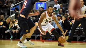 Toronto Raptors' Norman Powell, right, works around San Lorenzo de Almagro's Gabriel Deck during the first half of their NBA pre-season game Friday October 14, 2016 in Toronto. THE CANADIAN PRESS/Jon Blacker