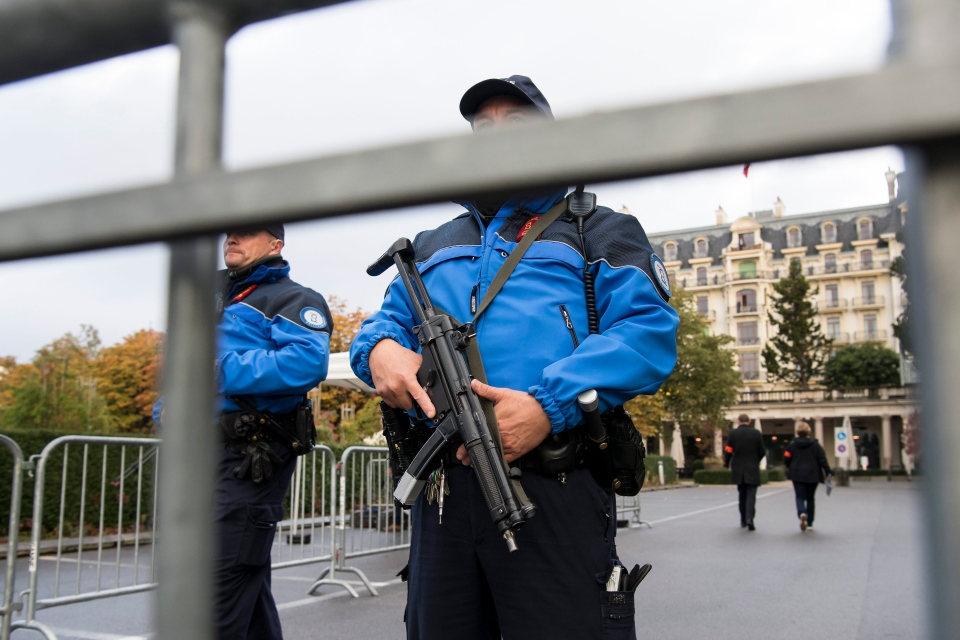 Swiss Police patrol outside the hotel prior to a meeting on the crisis in Syria, in Lausanne, Switzerland, Saturday, Oct. 15, 2016. (Jean-Christophe Bott / Keystone)