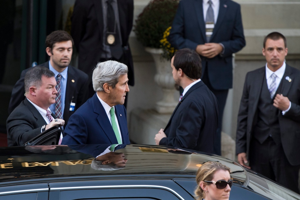 U.S. Secretary of State John Kerry, centre, arrives for a meeting to discuss the crisis in Syria, in Lausanne, Switzerland, Saturday, Oct. 15, 2016. U.S. (Jean-Christophe Bott / Keystone via AP)
