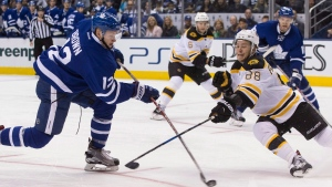 Toronto Maple Leafs' Connor Brown, left, makes a shot on goal under pressure from Boston Bruins' David Pastrnak during second period NHL hockey action, in Toronto on Saturday, October 15, 2016. (THE CANADIAN PRESS / Chris Young)