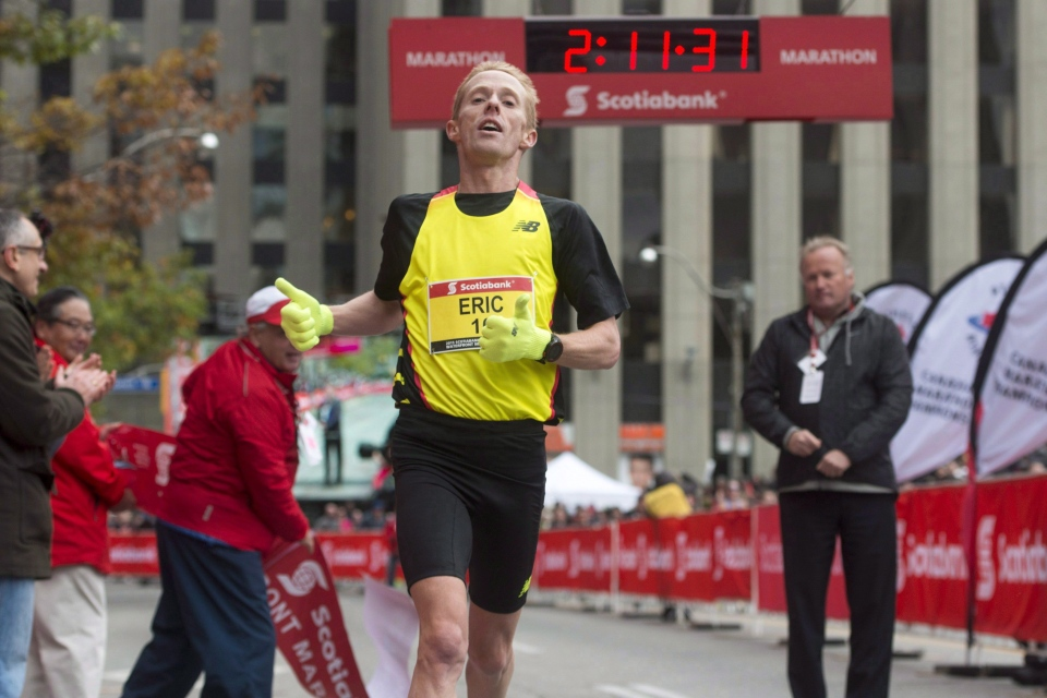 Canadian Eric Gillis crosses the marathon finish line and qualifies for the 2016 Rio Olympics during the Scotiabank Toronto Waterfront Marathon in Toronto, Sunday, Oct, 18, 2015. Gillis will take another stab at Canada's longstanding marathon record on Sunday, but this time he's got nothing to lose. THE CANADIAN PRESS/Marta Iwanek