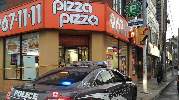 A police cruiser is shown in this image from the scene of a fatal shooting inside a Pizza Pizza in Weston on Oct. 16, 2016. (Arda Zakarian/CP24)