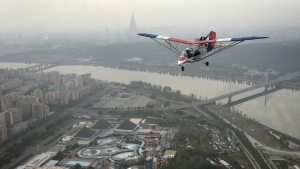 An ultralight aircraft flies over the city of Pyongyang in North Korea on Sunday, Oct. 16, 2016. (AP / Wong Maye-E)