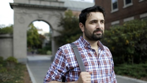 Khaled Almilaji, who coordinated a campaign that vaccinated 1.4 million Syrian children and risked his life to provide medical care during the country's civil war, stands for a portrait on the campus of Brown University in Providence, R.I. on Thursday, Oct. 13, 2016. (AP / Steven Senne)