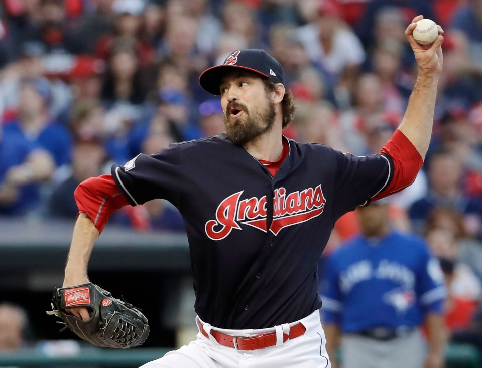 Cleveland Indians relief pitcher Andrew Miller throws against the Toronto Blue Jays during the seventh inning in Game 2 of baseball's American League Championship Series in Cleveland, Saturday, Oct. 15, 2016. (AP Photo/Matt Slocum)