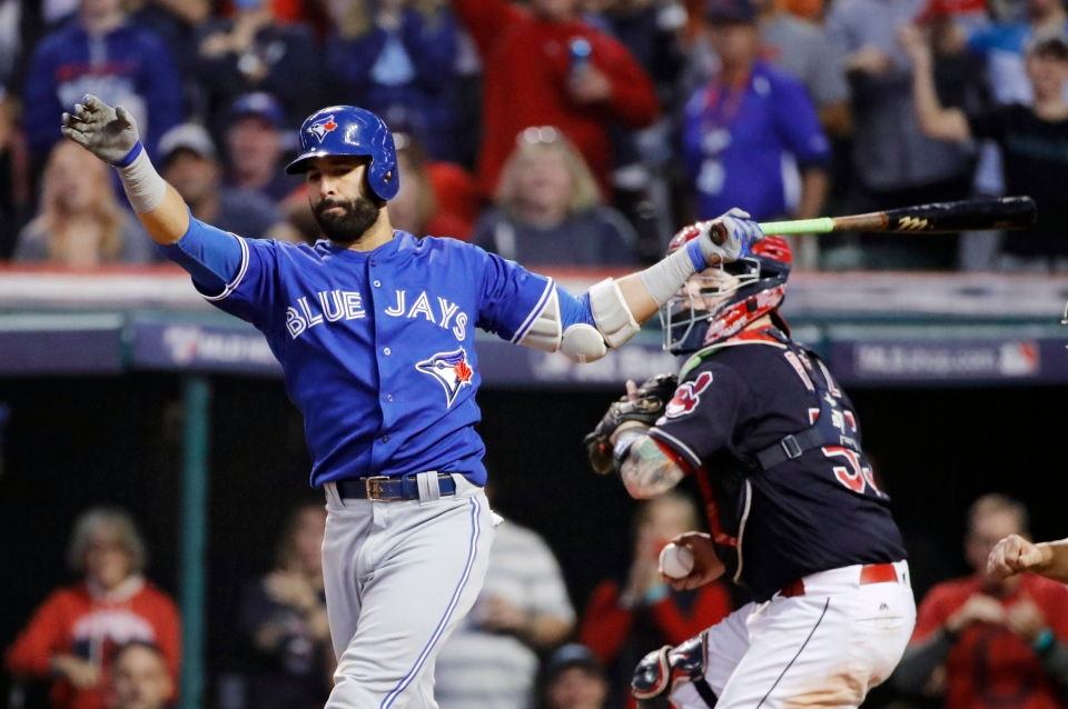 Toronto Blue Jays' Jose Bautista strikes out against the Cleveland Indians during the ninth inning in Game 2 of baseball's American League Championship Series in Cleveland, Saturday, Oct. 15, 2016. (AP Photo/Gene J. Puskar)