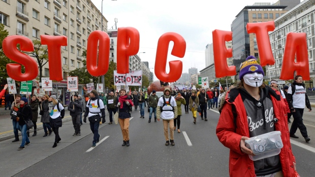 Anti-CETA protesters march in Warsaw, Poland